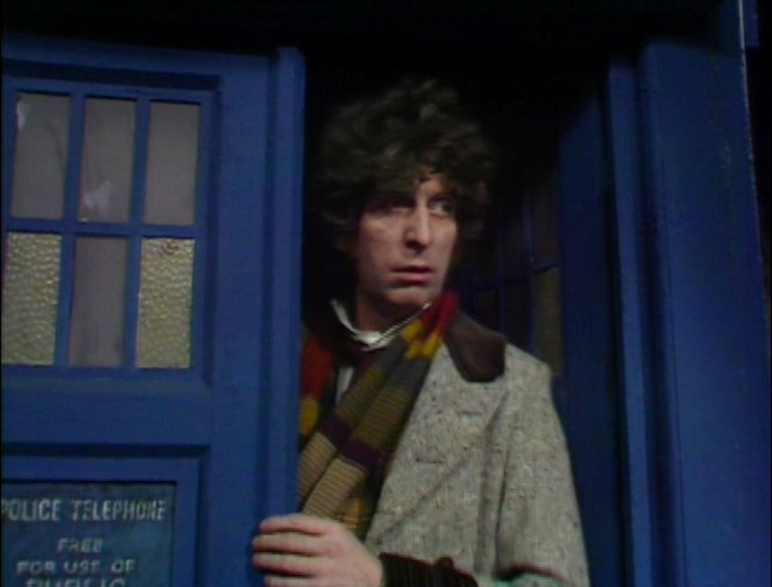 The Fourth Doctor, peering from the TARDIS doors