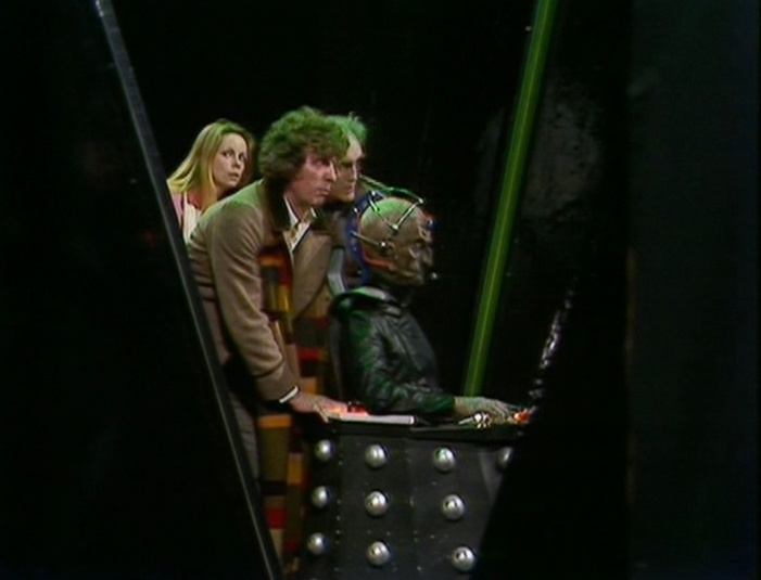 The Doctor wheeling Davros about