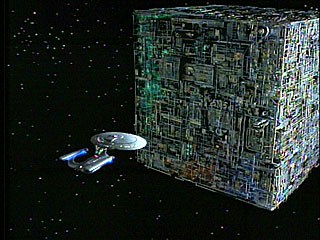 photo of Enterprise facing Borg Cube