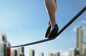 CIO walking on tightrope over cityscape