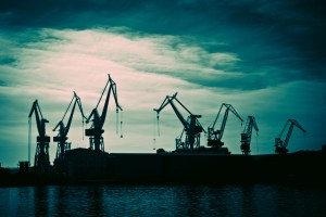 picture of shipyard cranes at dusk