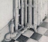Christopher Gallego, American, b. 1959, Kitchen Radiator, 2006, oil on board, 6 x 13 in..