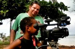 Jason Ramp trains a keen camera cadet on Badu Island. 2011