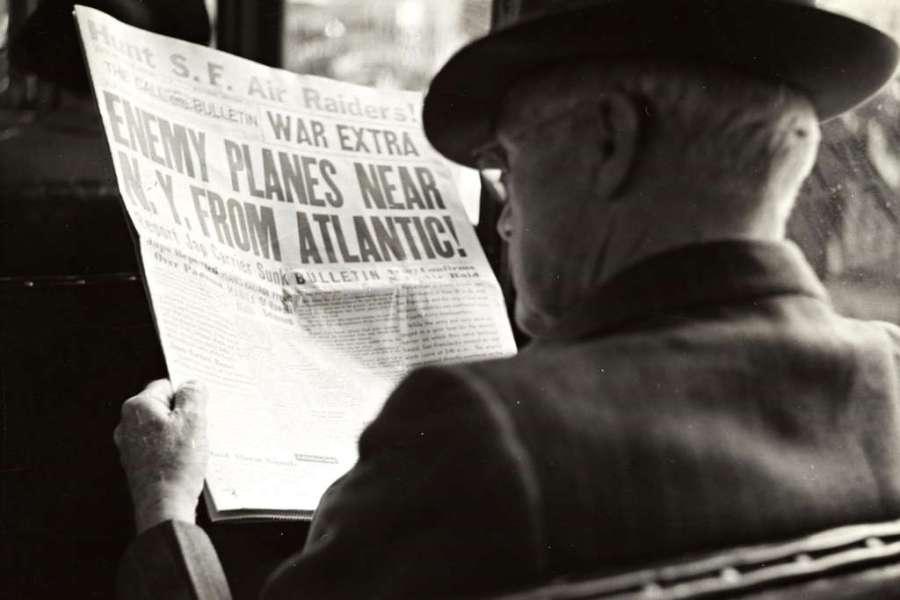 Man reading news paper