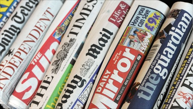 rolled up front covers of newspapers