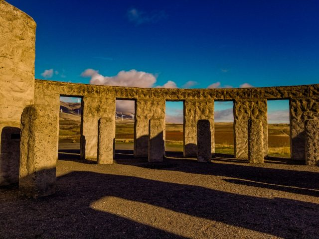 Maryhill's Stonehenge with wind turbines in the background