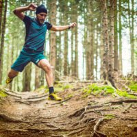 Ancestral health means eating, living, and moving like Paleo hunter–gatherers—like this man is doing during an intense trail run.