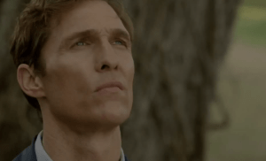 Screenshot of Matthew McConaughey in True Detective observing the opening crime scene
