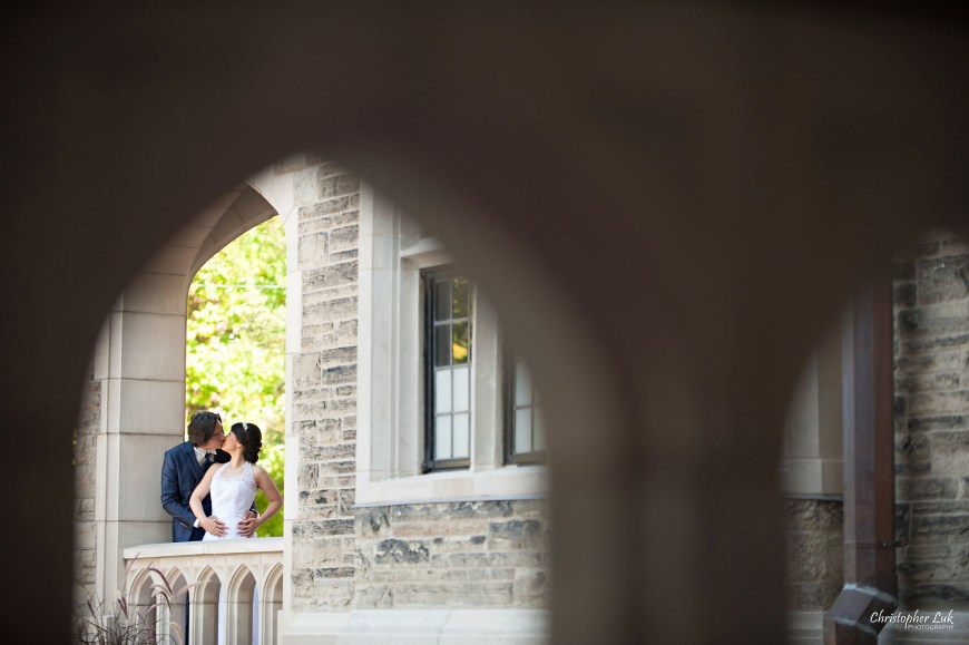 Christopher Luk 2014 - Mikiko and George's Casa Loma Wedding - Toronto Event Lifestyle Photographer - Bride and Groom Creative Relaxed Portrait Session Photojournalistic Natural Candid Exterior Castle Arch Hug Kiss