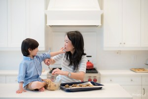 Christopher Luk 2015 - Toronto Family Toddler Winter Spring Indoor Home Session - Mom Toddler Son Boy Blue Grey White Striped Shirt Fashion Children Lifestyle Kitchen Centre Island Fun Candid Photojournalistic Finger Licking Cute