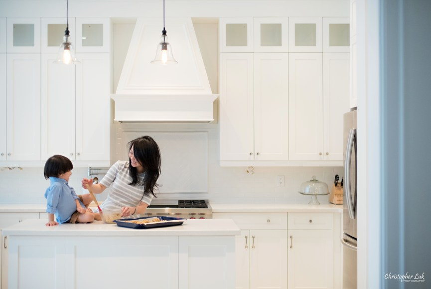 Christopher Luk 2015 - Toronto Family Toddler Winter Spring Indoor Home Session - Mom Toddler Son Boy Blue Grey White Striped Shirt Fashion Children Lifestyle Kitchen Centre Island Fun Candid Photojournalistic Finger Cute Baking Stirring Mixing Together