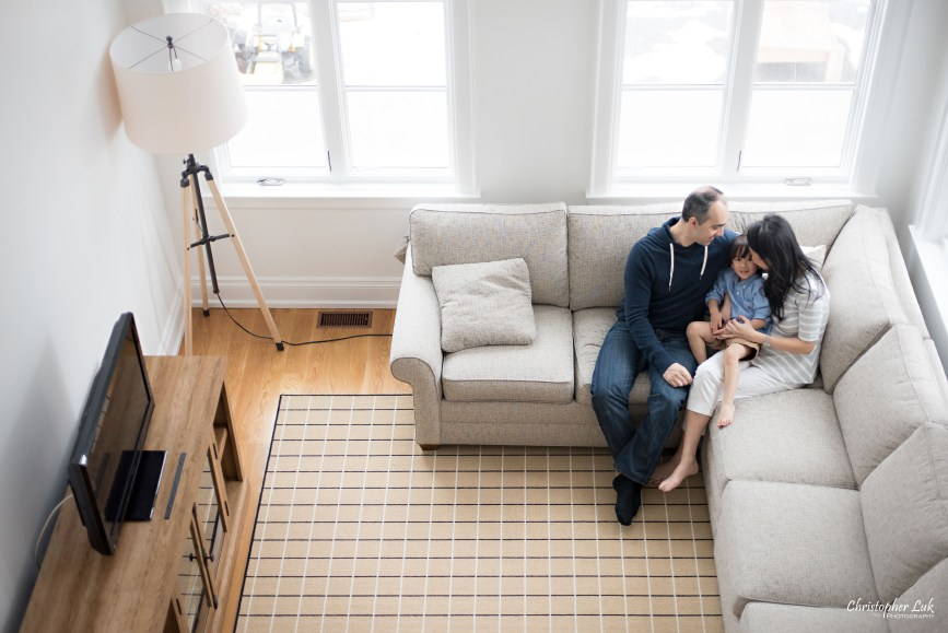 Christopher Luk 2015 - Toronto Family Toddler Winter Spring Indoor Home Session - Mom Dad Toddler Son Boy Blue Shirt White Grey Pants Jeans Fashion Couch Sectional Reclaimed Wood Table Console Stand Rug Lifestyle Photojournalistic Candid Tripod Floor Lamp