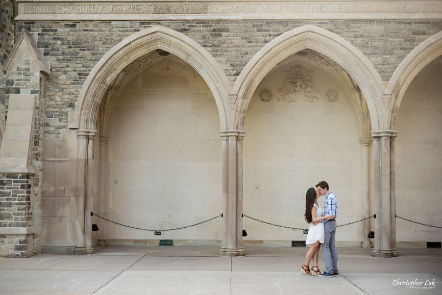 Christopher Luk (Toronto Wedding, Lifestyle & Event Photographer): Cindy and Matthew's University of Toronto Downtown Engagement Session - Bride Groom Natural Candid Photojournalistic University College Memorial Archway Hug