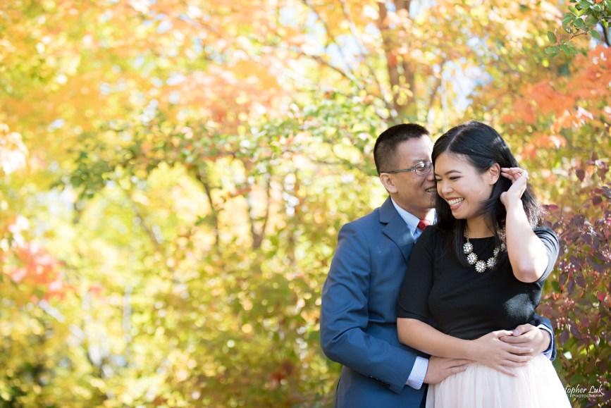 Christopher Luk - Toronto Vaughan Wedding Portrait Corporate Lifestyle Event Engagement Session PreWedding Photographer - The Doctor's House Main Street Kleinburg Conservation Woods Park Autumn Fall Leaves Bride Groom Pink Tulle Skirt Blue Suit Red Tie Golden Glowing Forest Trees Hug Crystal Necklace Smile