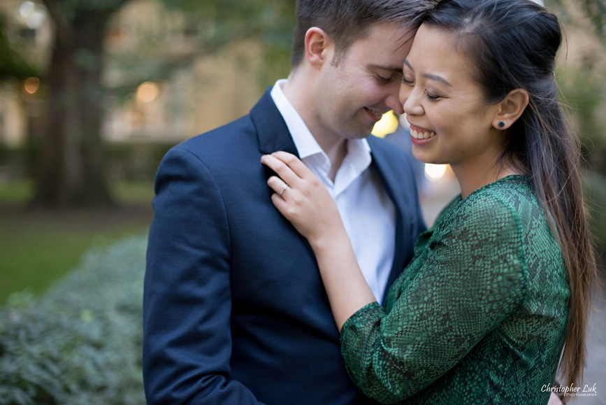 Christopher Luk (Toronto Wedding Photographer): University of Toronto College Doctor of Medicine Engagement Session Groom Natural Candid Photojournalistic Walkway Shrubs Old Trees Intimate Close Hold Tight Smile