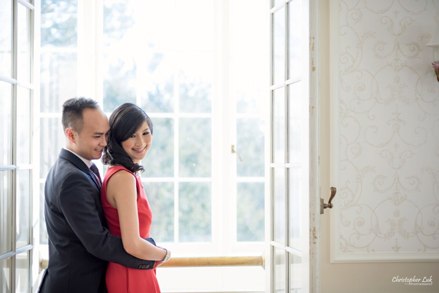 Christopher Luk (Toronto Wedding Photographer): Winter Indoor Engagement Session PreWedding Pictures Heintzman House Photos Markham York Region Natural Candid Photojournalistic Bride Groom Hug Balcony Window Doors Smile