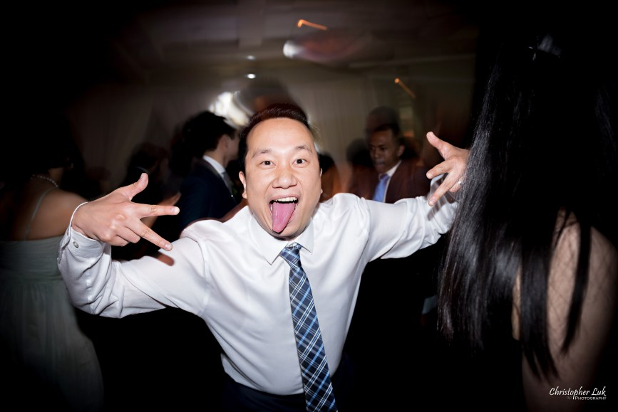 Christopher Luk: Toronto Wedding Photographer: Markham Museum Scarborough Chinese Baptist Church SCBC Columbus Event Centre Sala Caboto Natural Candid Photojournalistic Guests Family Friends Dancing Funny Faces Tongue Sticking Out Fingers