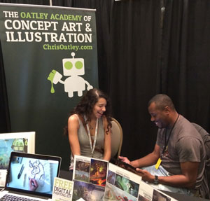 Justin Copeland reviewing story artist Marissa Livingston's portfolio at the Oatley Academy booth. Click the image to see Marissa's portfolio.