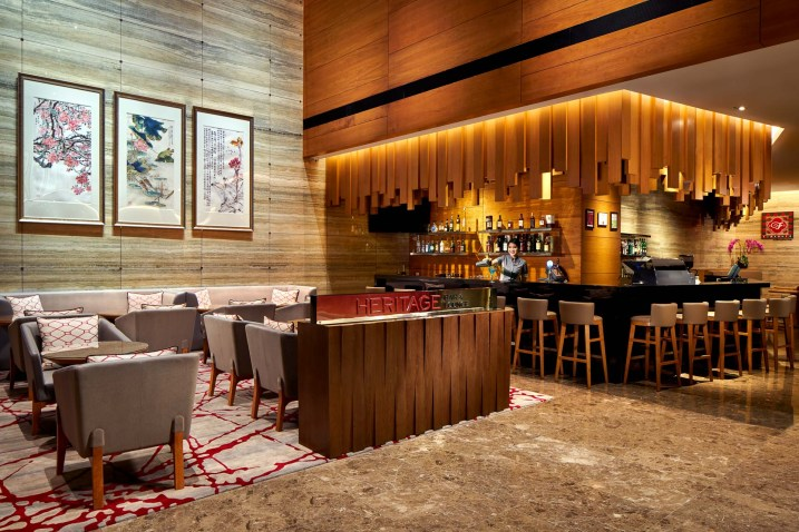 Interior Photography of the Ramada at Zhongshan Park Singapore hotel lobby bar called the heritage bar with bartender pouring drink