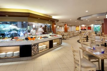 Interior photography of the wheelhouse restaurant showing chefs in the kitchen at tanglin club in singapore