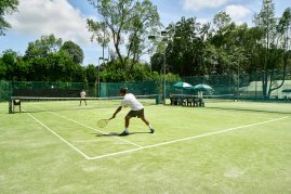 Lifestyle photography with people playing tennis at the swiss club singapore tennis courts