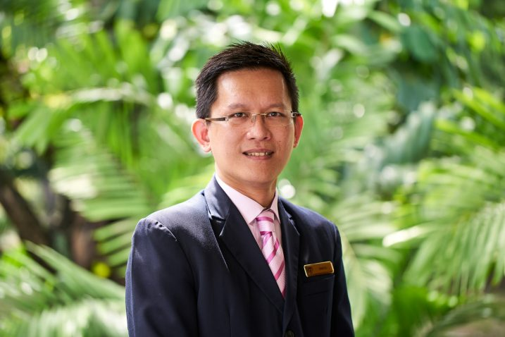 corporate portrait of young asian male staff at tanglin club in singapore