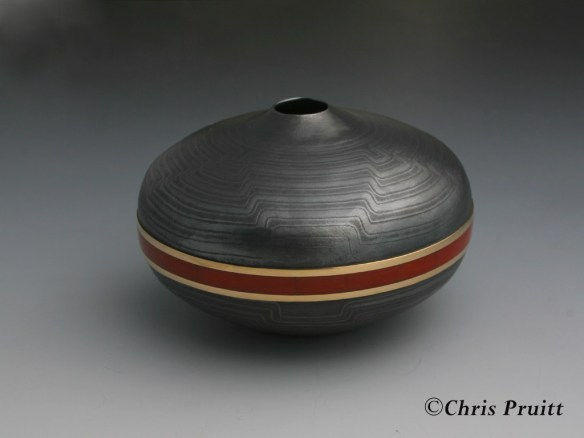 Raised Mokume Gane seedpot with 18k gold, and channel inlayed mediterranean coral. Finished with a heavy patina. Part of the Sanfield collection.