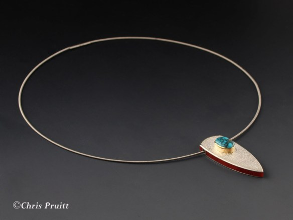 Fabricated pendent of sterling silver, 18k gold, natural Lone Mountain turquoise and channel inlayed mediterranean coral. On a stainless steel cable. #2