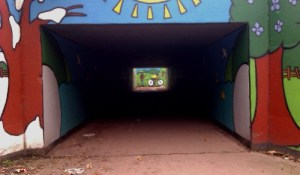 An dark underpass tunnel. The exit appears as a square patch of light.