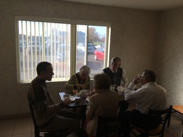Extended family enjoying breakfast before church on the wedding day.
