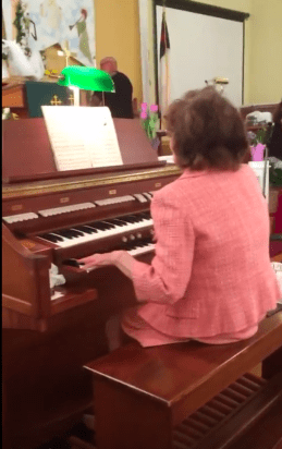 Mom playing the organ.