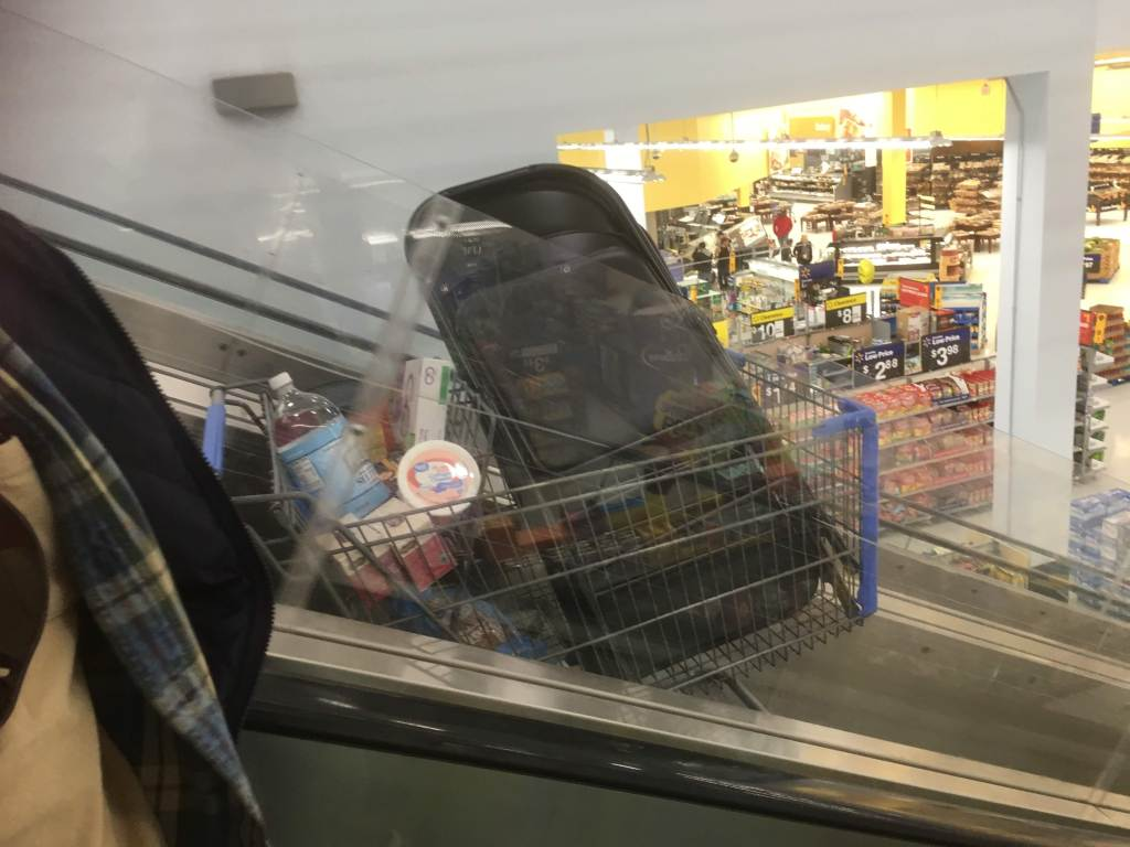 Chairs in cart going down escalator