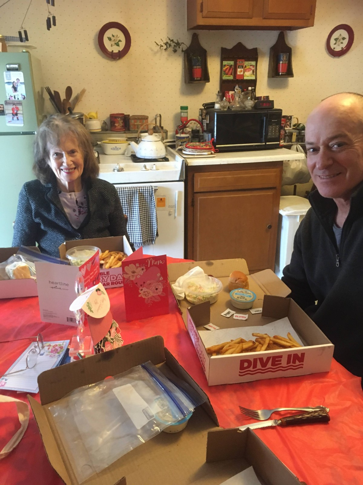 Mom and Chris eat fish on Valentines Day