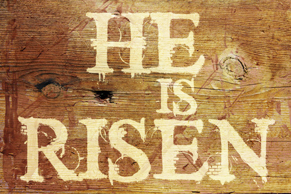 He is Risen painted on wood