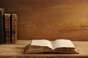 old book open on wooden shelf