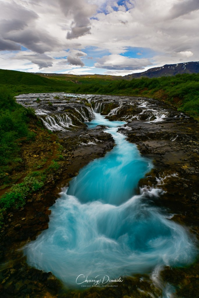 celandic waters cascading to a glacier blue swirl in summer.