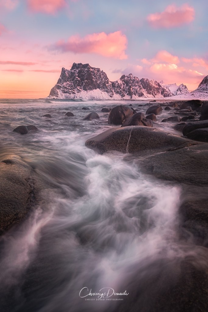 Winter sunset with the sweeping waves along the Norwegian Fjords
