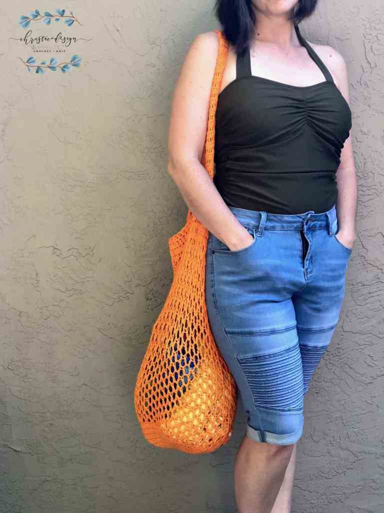 picture of woman with orange market tote bag on shoulder
