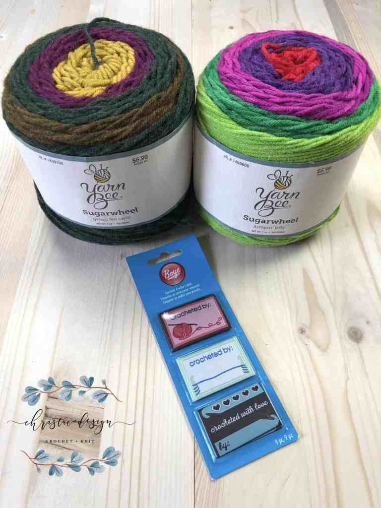 picture of two sugar wheel yarn cakes and labels