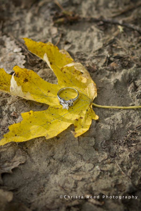 picture of a wedding ring placed on a brightly colored fall leaf