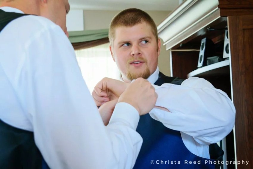 groom gets ready for his wedding at home in Belle Plaine Minnesota