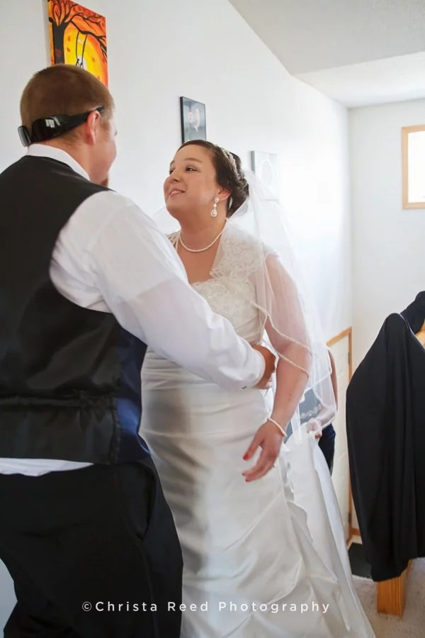 couple enjoys a first look at home before their Belle Plaine wedding