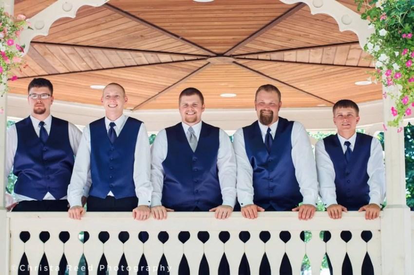Groomsmen and groom pose in a gazebo for belle plaine wedding