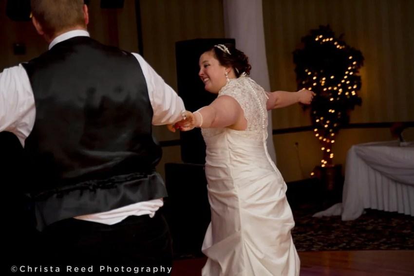 first dance groom swings bride