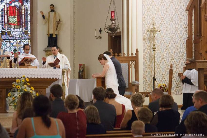 praying during wedding mass at st peter and paul in mankato