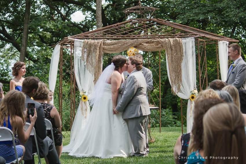 first kiss at chanhassen outdoor wedding