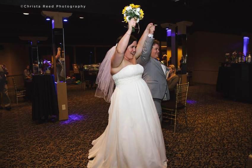 couple makes grand entrance at wedding reception