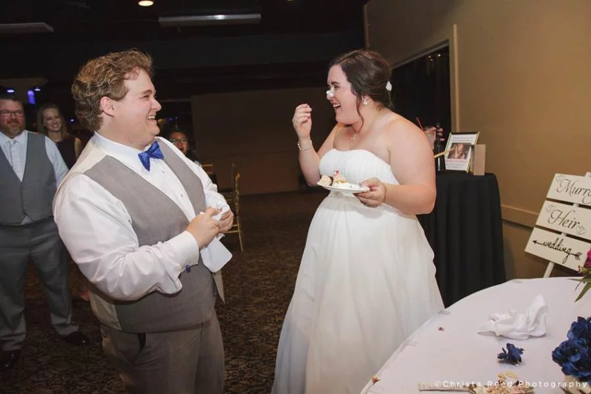 bride has cake in her face after food fight