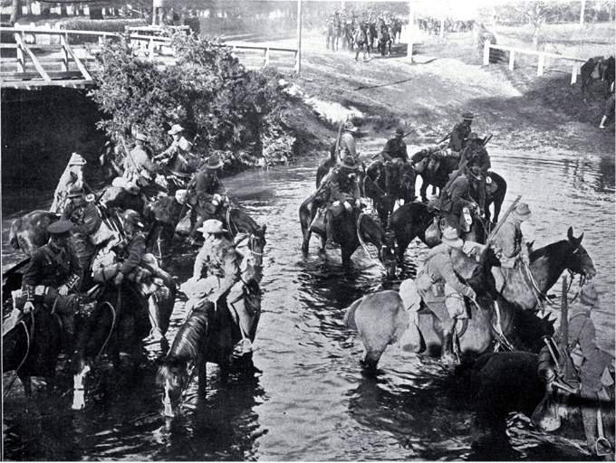Troops watering horses in the Avon River near Carlton Bridge, Christchurch [23 Sept. 1914]. CCL PhotoCD 7, IMG0069