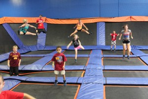 kids jumping on trampolines